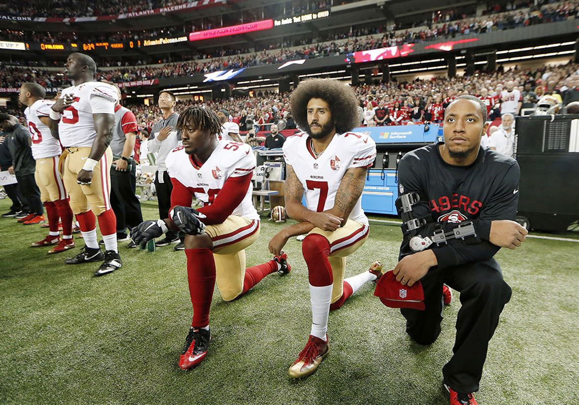 7a4b3c48fd5 San Francisco 49ers quarterback Colin Kaepernick (7) and outside linebacker  Eli Harold (58. 5. MORE. For 100 years, national anthem ...