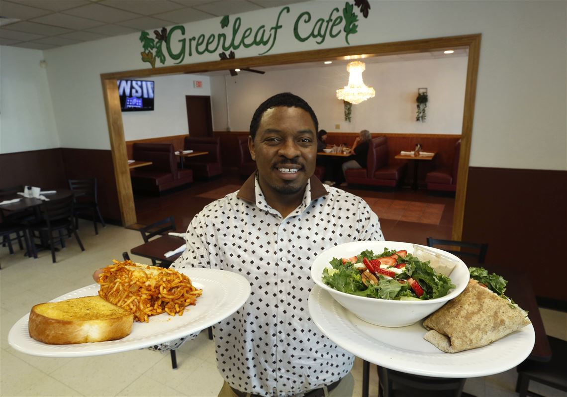 Owner Robert Harris Holds Two Of His Vegetarian Dishes At Greenleaf Cafe In Toledo