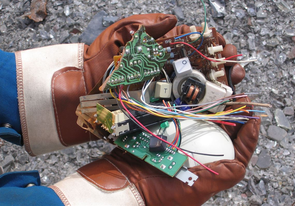 A Teck Resources Ltd Employee Holds Shredded End Of Life Electronics Also