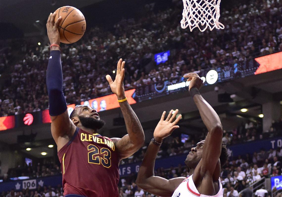 98bdeeadc356 Cleveland Cavaliers forward LeBron James (23) shoots over Toronto Raptors  forward Pascal Siakam during