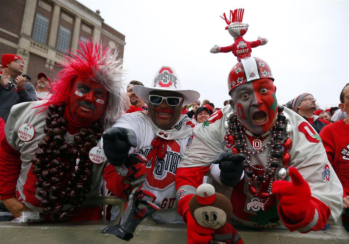 more photos e9e83 777b8 Ohio State fans Larry Lokai, left, John Chubb, center, and Jon P