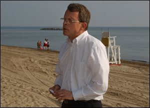 Mike DeWine, then a United States Senator, speaks on the shores of Lake Erie at East Harbor State Park in Port Clinton in 2004.