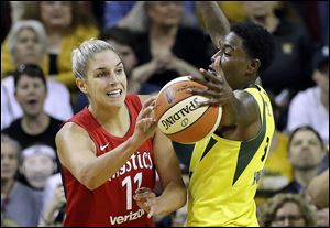 Seattle's Natasha Howard, right, deflects a pass by Washington's Elena Delle Donne in the second half of Game 2 of the WNBA Finals. Howard finished with eight points and a game-high 13 rebounds in the Storm's win.
