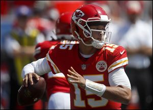 Kansas City Chiefs quarterback Patrick Mahomes passes against the Los Angeles Chargers during the first half of Sunday's opener.