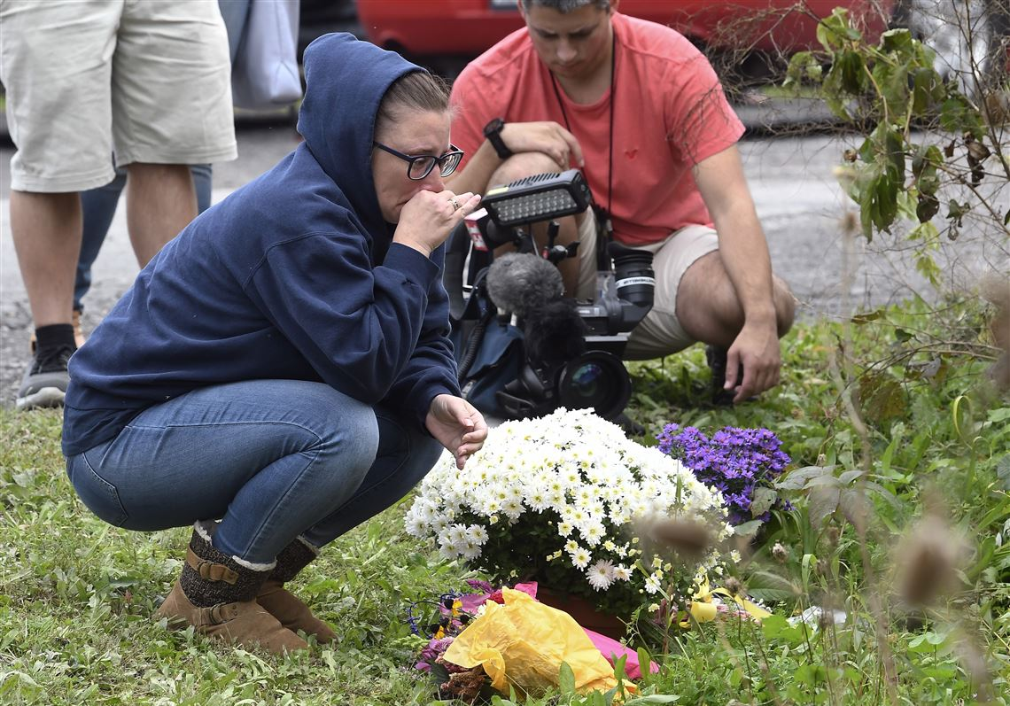 People Place Flowers Sunday At The Scene Where 20 Died As Result Of