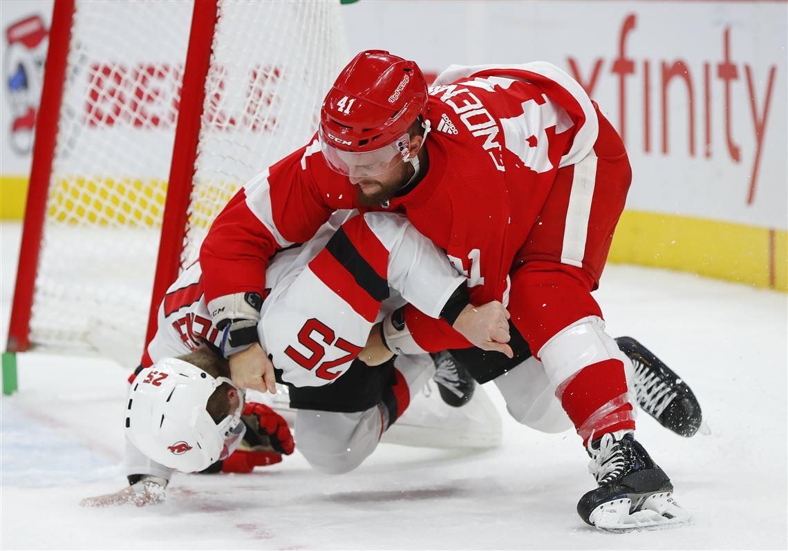 26fc8e201 Detroit Red Wings center Luke Glendening and New Jersey Devils defenseman  Mirco Mueller fight during the