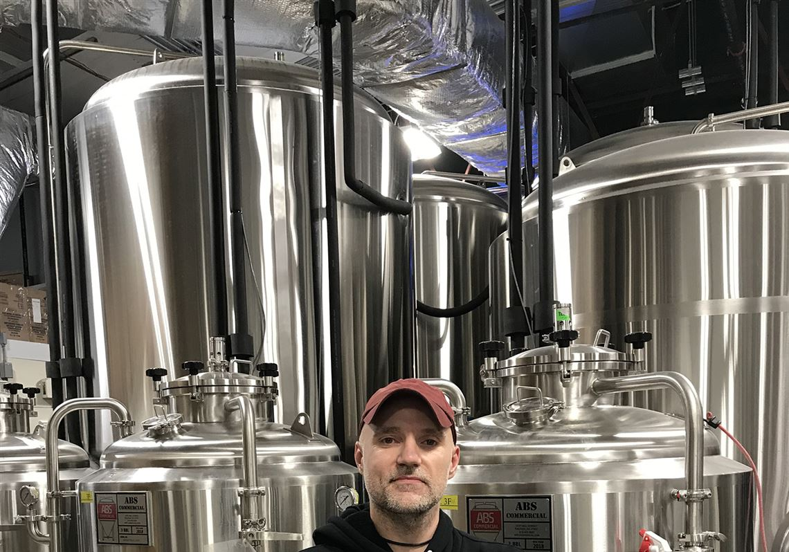 Aaron Osborne, co-owner of Findlay Brewing Company, shows off the taproom in downtown Findlay.