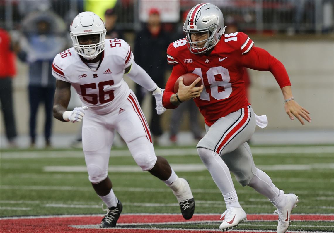 21a2b17a619 Ohio State quarterback Tate Martell, right, runs past Rutgers linebacker  Rashawn Battle to score