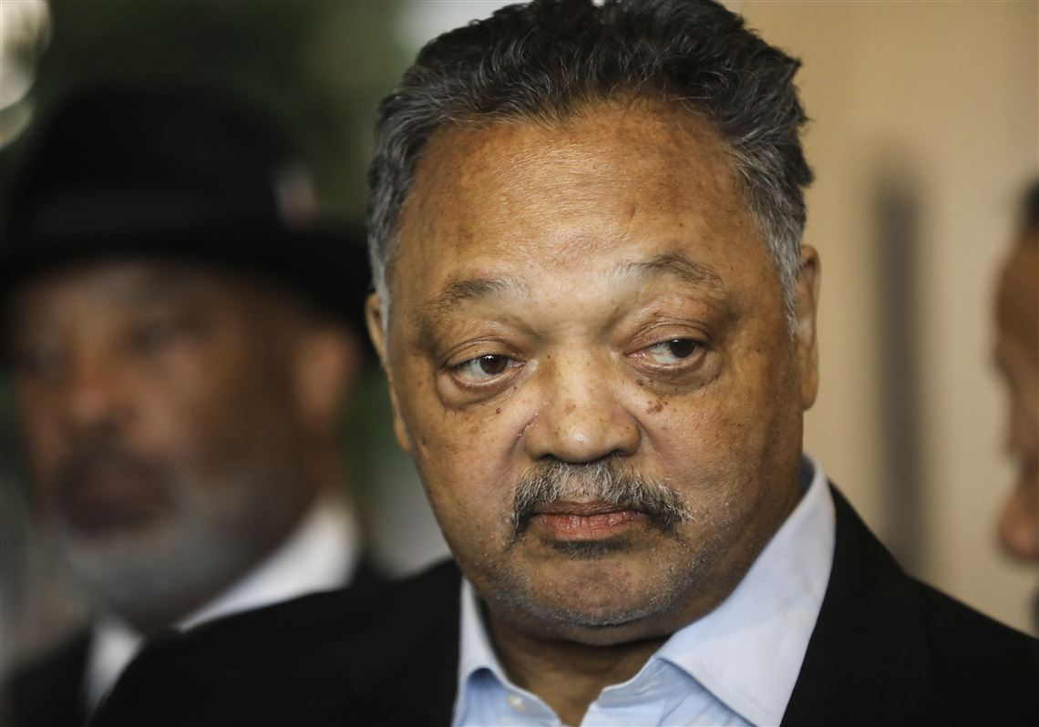 94eefacbda8 Jesse Jackson listens to Ray Woods talk about his experience working at the  GM