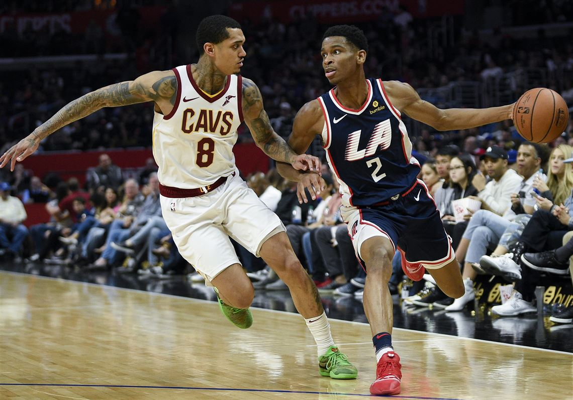 cce373a6acc Los Angeles Clippers guard Shai Gilgeous-Alexander, right, drives past Cleveland  Cavaliers guard