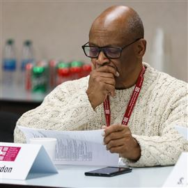 Reverend Otis Gordon looks at the agenda during planning and oversight committee meeting held by the Mental Health and Recovery Services Board of Lucas County in Toledo on Tuesday February 11, 2020.