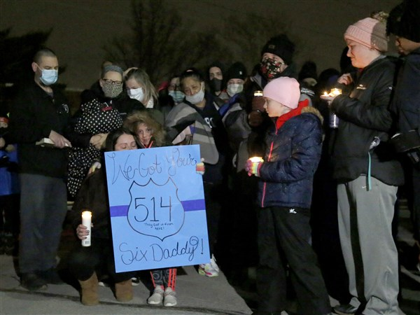 Family, community pay tribute to fallen Toledo police officer at vigil
